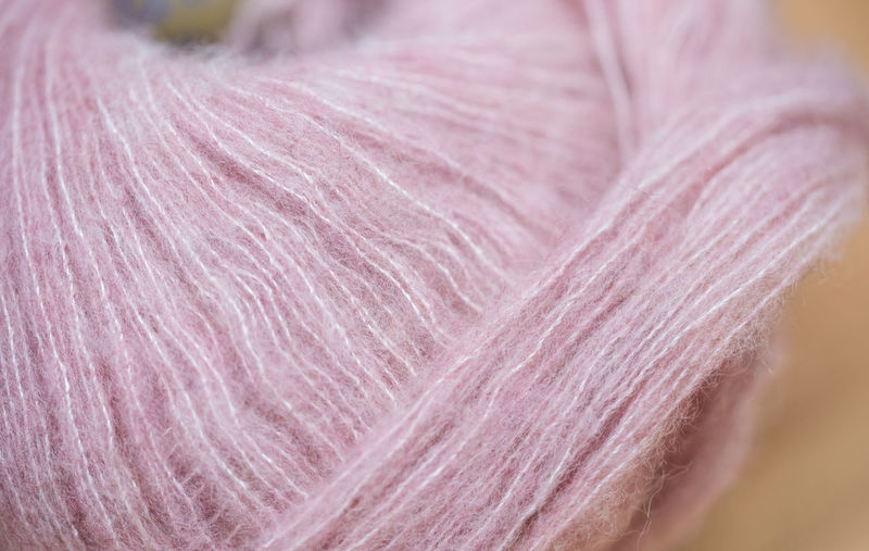 Wool Textile Art And Craft Craft Softness Material Close-up Thread Pink Color Ball Of Wool Creativity Indoors  No People Industry Man Made Object Man Made Fiber Selective Focus Textile Industry Purple Hairstyle