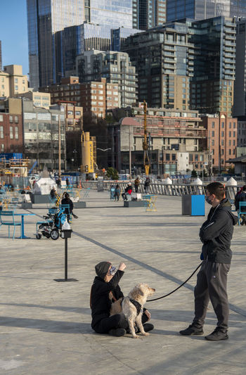 People with dog in city
