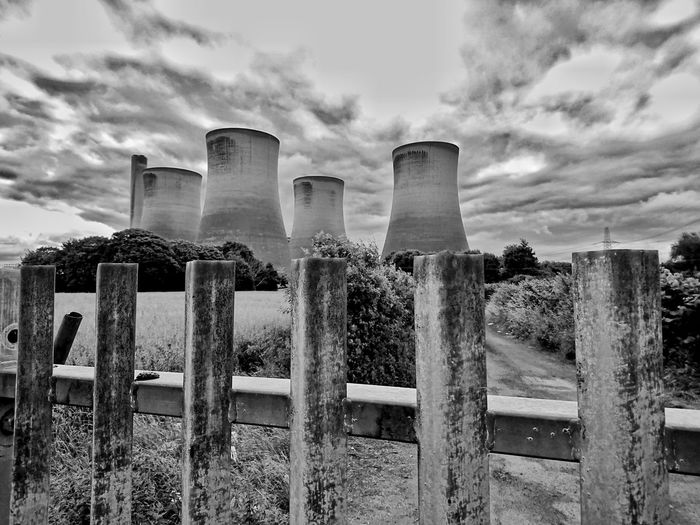 No entry to the stacks // Sky Built Structure No People Architecture Building Exterior Water Outdoors Day Industry Blackandwhite Black And White Industry Chimneys Industrial Chimney Stacks EyeEm Best Edits Chimney Smoke Stock Photo Eyeemphotography Photooftheday Pollution In My World Pollution Nature Tree Architecture