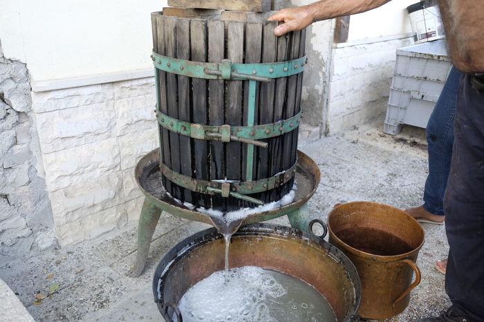 homemade wine production Ancient Antique Hands Homemade Juice Must Press Crushing Grapes Making Pressure Processing Squeeze Wine Winery