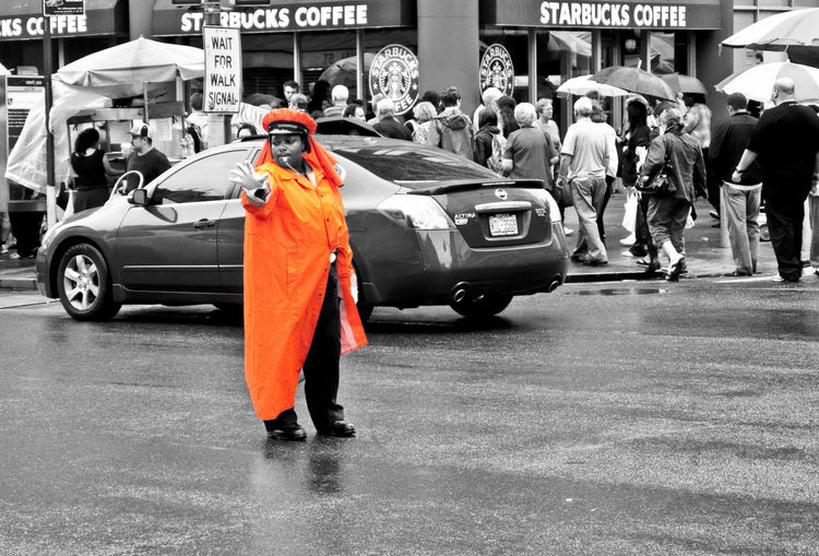 Orange Color Cut Out Traffic Street Road Day Clothing Protection Uniform Rain Rainy Season Land Vehicle City Real People Car Motor Vehicle Mode Of Transportation Transportation The Art Of Street Photography Starbucks Starbucks Coffee