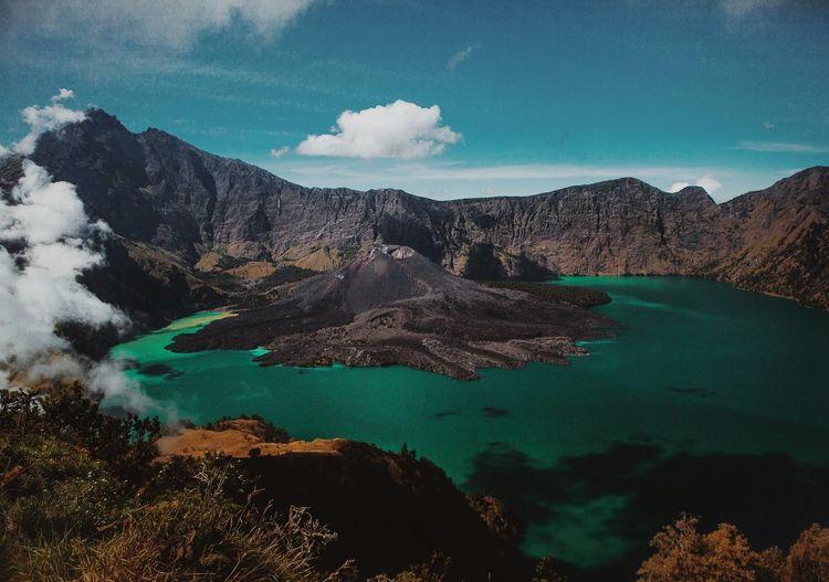 Crater Lake At Mount Rinjani Against Sky