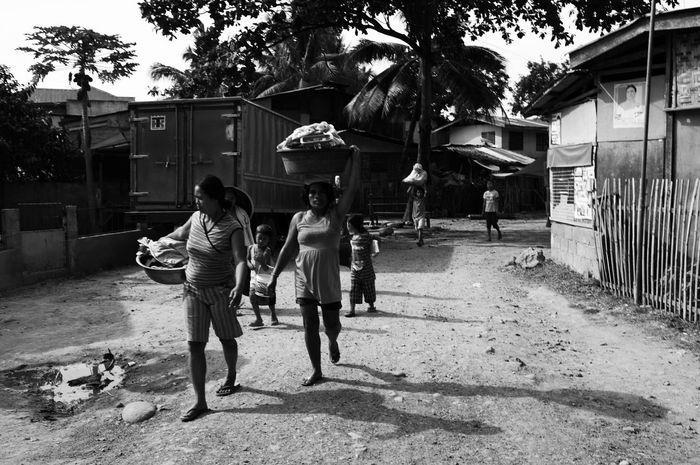 As the mothers are on there way to the river to wash their soiled clothings, the children are ready and excited for a swim. Monochrome Social Documentary Everydaylife The Human Condition Hobbyist Eyeem Philippines Taking Photos Streetphoto_bw Enjoying Life