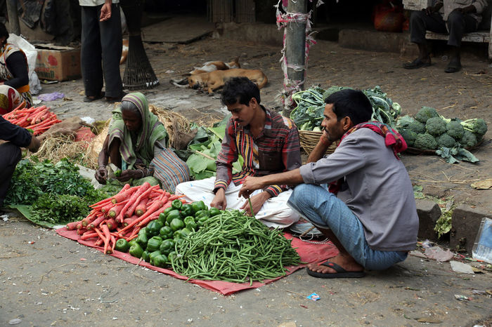 Street trader sell vegetables outdoor on February 11, 2014 in Kolkata India. Assortment Bazaar Buisness Calcutta Carrot City Customer  Food Fruit Green Beans Greengrocery Grocery India Kolkata Market Marketplace Paprika Sale Seller Shop STAND Street Vegetables