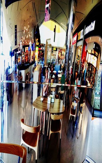 The world in a metal column... Architecture Bar Break The Mold Chair Coffee Time Columns Day Indoors  Metal Columns Real People Reflections Restaurant Table