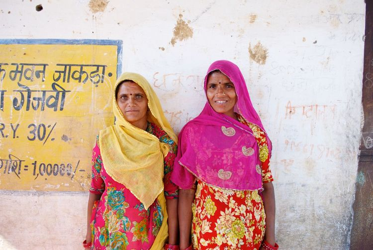 Women Around The World India Childfund Women Colors Love Two women stop their discussion about their village saving loan to allow me to take their photo. With savings, women groups are able to pool money for emergency expenses and are also able to obtain financial independence from their husbands. Empower The Portraitist - 2017 EyeEm Awards Neon Life