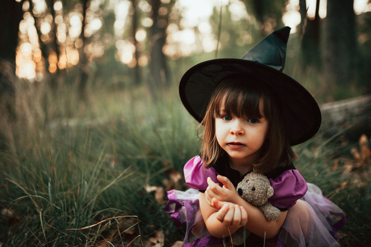 Portrait of girl with toy on field