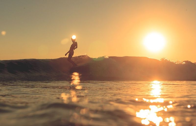 Sea Surf Surfer Surfingphotography Longboarder Bingsurfboards Ponzanelli Sunset Sun Illuminated Beauty In Nature Reflection Nature Scenics Water Tranquility Waterfront Tranquil Scene Outdoors Real People Lifestyles One Person Sky Mountain People