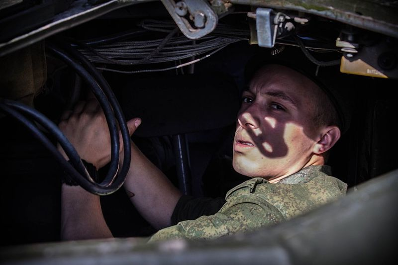 Soldier Sitting In Military Vehicle