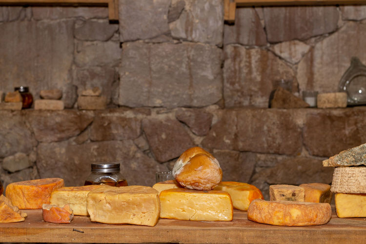 Various food on display against wall at store
