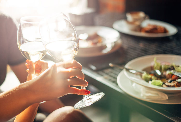 woman drinking white wine Woman Alcohol Close-up Day Drink Drinking Glass Food Food And Drink Freshness Golden Hour Holding Human Body Part Human Hand Leisure Activity Lifestyles Men Real People Refreshment Table Two People Wine Wineglass Women