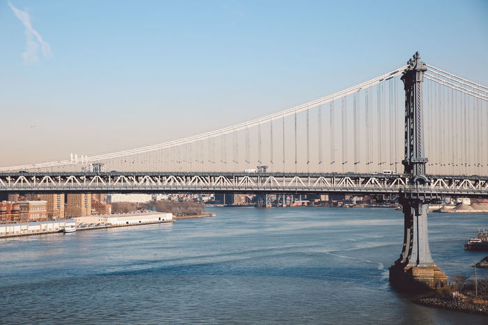 Architecture Bridge Bridge - Man Made Structure Built Structure Business Finance And Industry City Cold Connection Day December Engineering Manhattan Bridge New York New York City Outdoors River Sky Sunny Suspension Bridge Tourism Transportation Travel Travel Destinations Water Winter