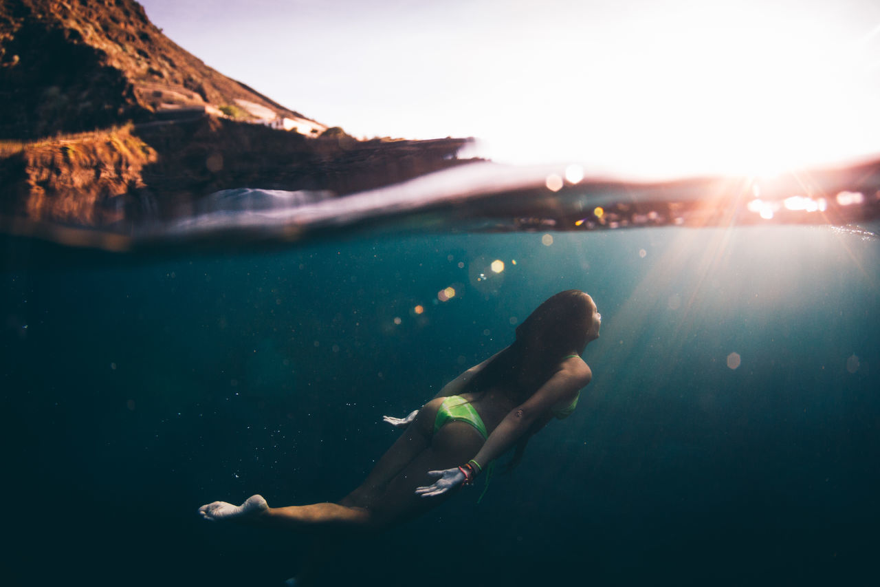 Full length of woman swimming in sea at canary islands