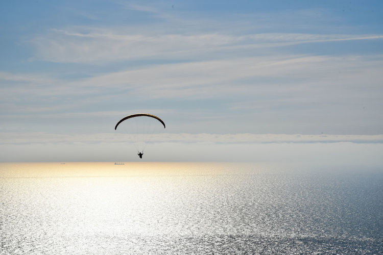 Handglider over the sea Handgliding Adventure Beauty In Nature Cloud - Sky Day Extreme Sports Horizon Horizon Over Water Idyllic Kiteboarding Nature Outdoors Parachute Scenics - Nature Sea Seascape Sky Sport Tranquil Scene Tranquility Unrecognizable Person Water Waterfront