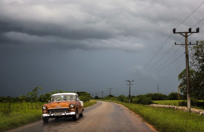 Car on road in Matanzas, Cuba. Cuba Beauty Bestdestinations Cable Car Cloud - Sky Day Electricity Pylon Field Land Vehicle Landscape Mode Of Transport Nature No People Old And Beautiful Outdoors Road Rural Scene Sky Storm Storm Cloud Thunderstorm Transportation Tree Weather