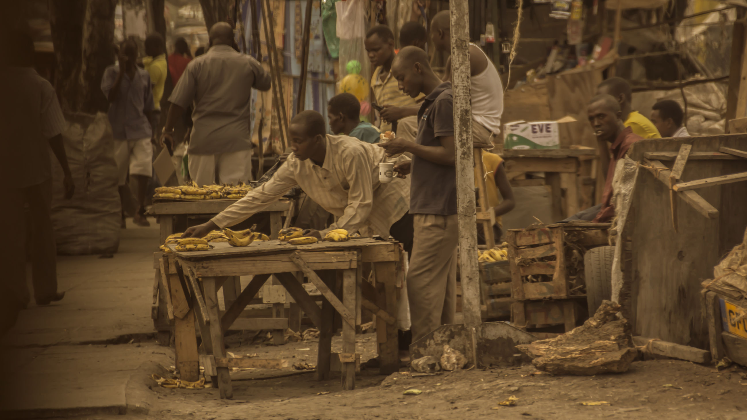 men, occupation, real people, working, group of people, wood - material, day, people, standing, outdoors, lifestyles, rear view, architecture, group, full length, skill, seat, adult, market, log