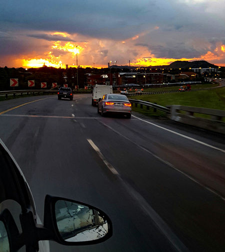 Sunsetting Clouds Sunset Car Transportation Mode Of Transport Cloud - Sky Road No People City Life TravelCityscape Sky Journeyphotography Sunset And Clouds  Orange Sky Orange Sunset Orange Sky Sunset Orange Sky And Clouds Sunsets Johannesburg South Africa South African Photography Southafrica SouthAfricansunset Car Mirror