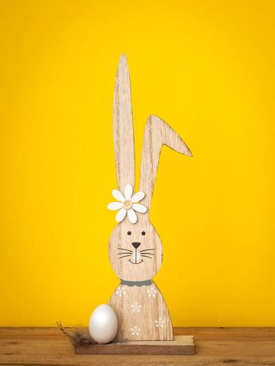 Easter White Bunny  Yellow Copy Space Space Typical Eggs Decoration Background Spring Happy Season  Celebration Concept Holiday Beautiful Decorative Symbol Figure Traditional Rabbit Color Wooden Nest Design Decor Style Tradition April Modern Cute Card Interior Greeting
