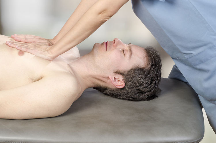 Physiotherapist, chiropractor is doing a lungs visceral fascia. Massage to a man patient. Osteopathy Back Doctor  Man Medicine Pain Therapy Woman Cervical Chiropractor Clinic Healthcare And Medicine Injury Manipulation Massage Medical Muscles Muscular Patient person Physiotherapy Professional Stretching Therapist