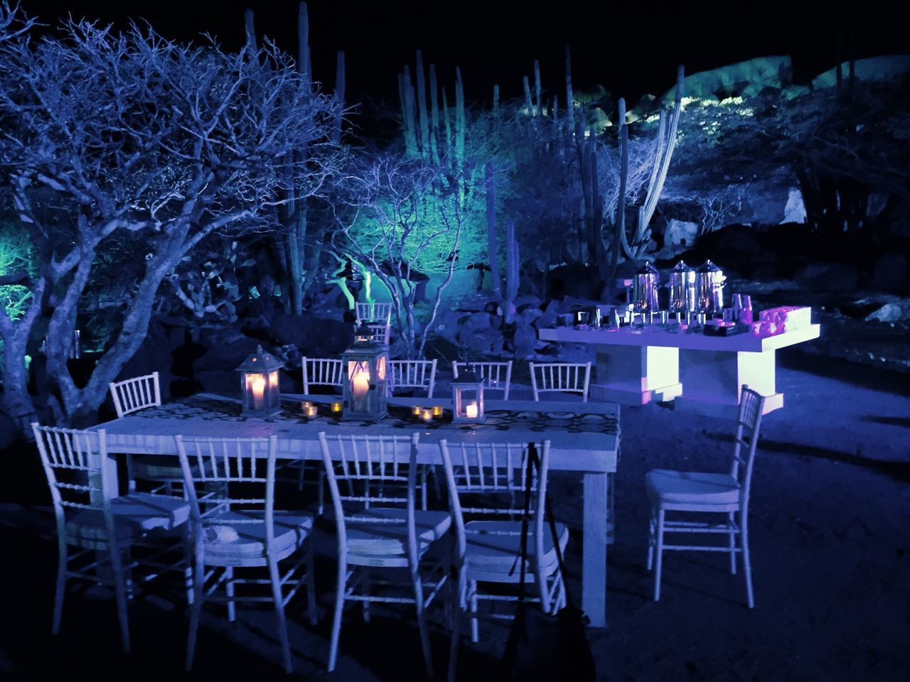 table, night, candle, chair, illuminated, empty, place setting, burning, flame, restaurant, dining table, outdoors, spirituality, no people, wineglass, seat, flower