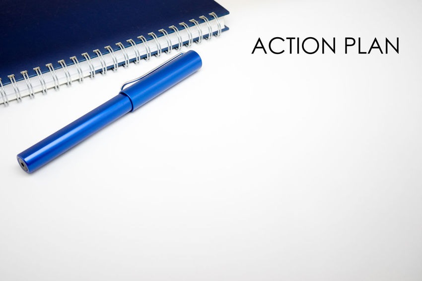 Word Action Plan with notebook and pen in white isolated background Action Plan Blue Checklist Close-up Education Green Color Idea Isolated White Background Multi Colored No People Notebook NotePad Notes Pen Stationary Still Life Studio Shot White White Background