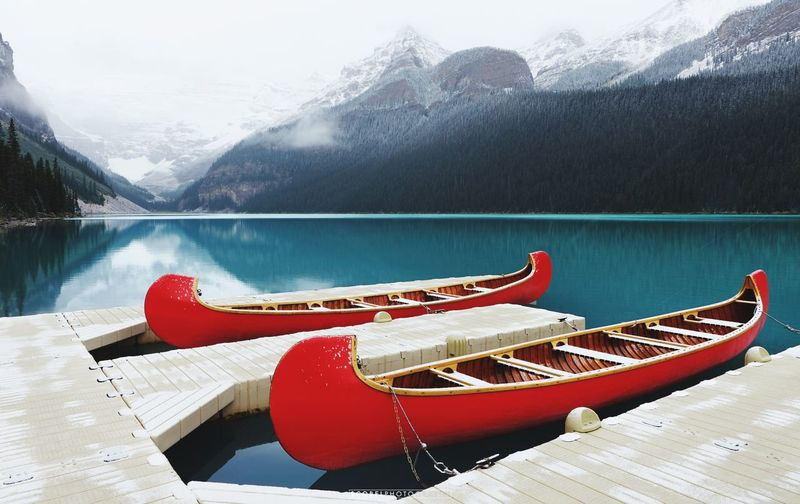 Canoes Moored At Lakeshore During Winter