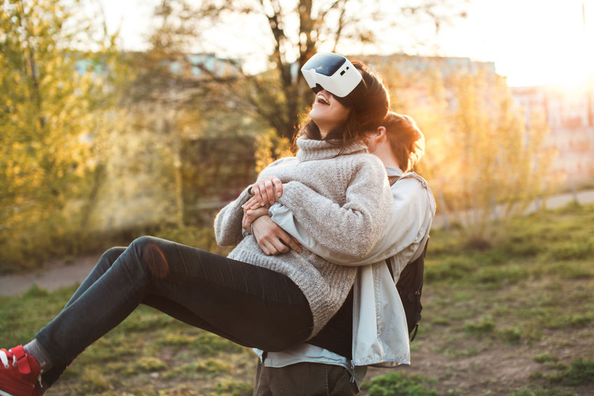 Couple of young adults playing with VR headsets Couple Friends Fun Grass Love Virtual Reality Friendship Headset Joy Outdoors Park Real People Summer Technology Vr