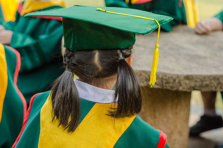 Rear View Of Woman In Graduation Gown