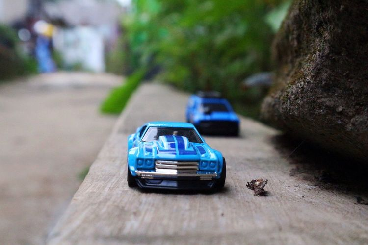 Cars Car Toy Car Toy Mode Of Transportation Motor Vehicle Transportation Blue Land Vehicle Day Outdoors Close-up Land High Angle View Still Life Sunlight Selective Focus No People Nature Plant