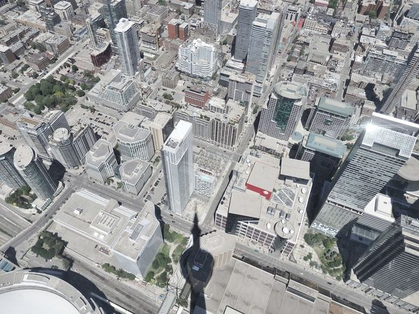Aerial View Architectural Feature Architecture Architecture Building Exterior Built Structure City City Life Cityscape CN Tower CN Tower - Toronto Famous Place Focus On Shadow International Landmark Modern Skyscraper Tall - High Tower Eyeem Collection At Getty Images