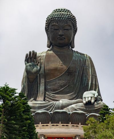 Big Buddha Tian Tan Buddha Buddha Statue Sculpture Religion Statue Belief Human Representation Spirituality Male Likeness Representation Art And Craft Place Of Worship Built Structure Architecture Sky Low Angle View Creativity Building Day No People Idol Outdoors