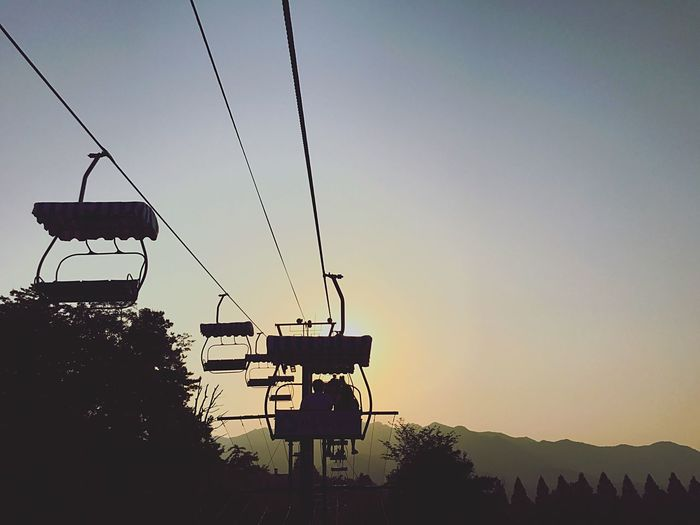 Live For The Story Sunset Silhouette Clear Sky Outdoors Nature Sky Overhead Cable Car Beauty In Nature Ski Lift The Great Outdoors - 2017 EyeEm Awards