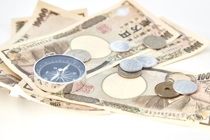 Close-up of currency over white background