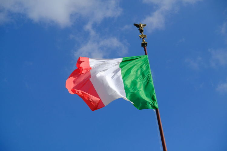 Italian flag waving against blue sky Green White Red Italia Nationalism Patriotic Patriotism Rome Day Flag Green Color Italian Flag Italy Low Angle View National Flag No People Outdoors Patriotism Verde Bianco Rosso