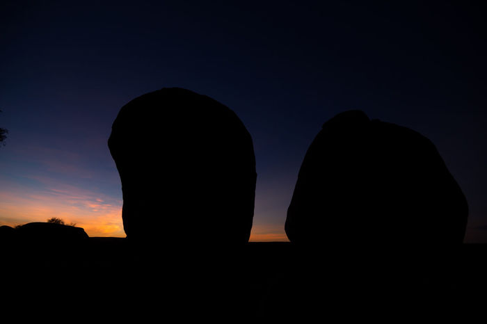 Sunrise at the Devils Marbles in the australian outback. Beauty In Nature Black And Colors Devils Marbles Morning Morning Light Nature Outdoors Rock - Object Rock Formation Scenics Silhouette Silhouettes Sky Sunrise Togetherness Tranquil Scene Tranquility