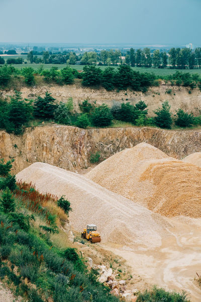 Minerals Day Dirt Dust Environment Field Geology High Angle View Industry Land Land Vehicle Landscape Machinery Mine Mode Of Transportation No People Outdoors Plant Quarry Road Stone Surface Mine Transportation Truck Vehicle