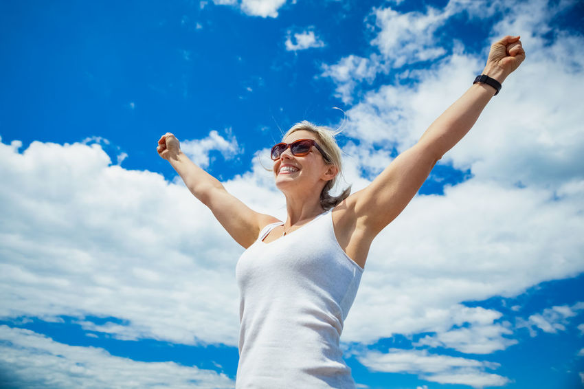 Beautiful woman with arms in the blue sky celebrating success Achievement Adult Arms Athlete Beautiful Females Happy Happy People Nature Woman Adventure Arms In The Air Arms Outstretched Cloud - Sky Clouds Fitness Healthy Lifestyle Hiker Outdoors Outside Peaceful person Reaching For The Sky Success Summer