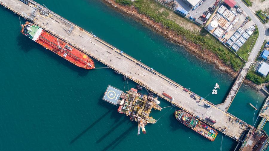 High angle view of ship moored at harbor
