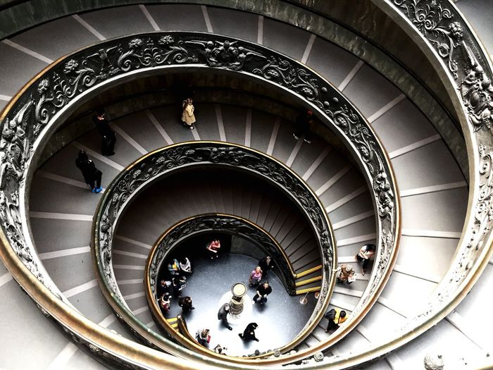 High Angle View Of People On Spiral Staircase In Vatican Museums