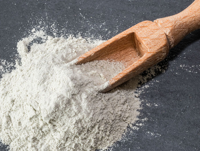 Close-up of flour and spoon on granite