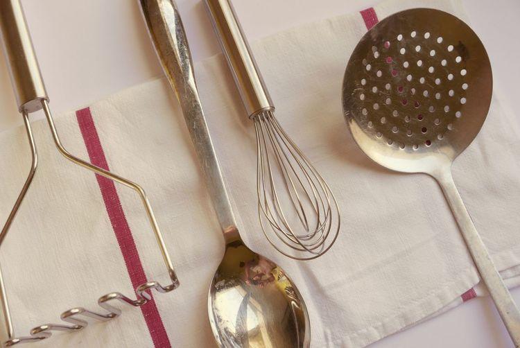 Close-up of kitchen utensils on napkin