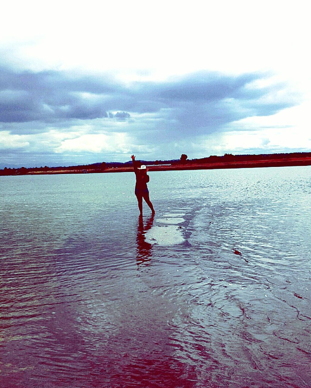 sky, water, cloud - sky, real people, sea, one person, standing, beauty in nature, waterfront, nature, leisure activity, lifestyles, day, full length, scenics - nature, reflection, tranquility, men, outdoors