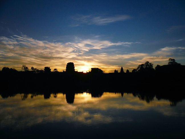 Sunrise over Angkor Wat, Cambodia Stillness Peaceful Moment Early Morning Quiet Moment Sunrise Angkor Wat Angkor Angkorwat Angkor Wat, Cambodia Angkor Temple Cambodia Siem Reap Angkor Wat Sunrise Sunset Angkor Wat Sunset Reflection Sky And Water Sunrise Silhouette Silhouette Angkor Wat Silhouette Sunrise Over Angkor Wat Travel Destinations Travel Cambodia Travel Asia Explore Cambodia