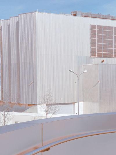 White building against sky in winter