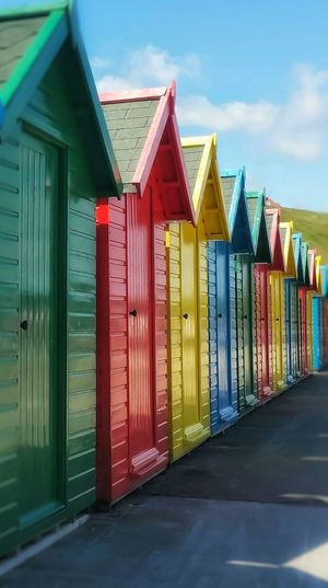 Beautiful seaside cabins of Whitby Multi Colored Beach Built Structure Outdoors Architecture Travel Destinations Fujifilm Malephotographerofthemonth Creative Light And Shadow The World Through My Eyes Whitby North Yorkshire Whitby Beach Sea Vacations Leisure Activity Cabins