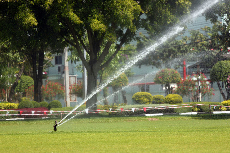 Sprinkler was in the lawn water injection. Injection Sprinklers Architecture Day Fountain Gardening Gardening Equipment Grass Growth Irrigation Equipment Lawn Lawn Art Motion Nature No People Outdoors Park Plant Spraying Sprinkler Sprinkler System Tree Water Waterfall Watering