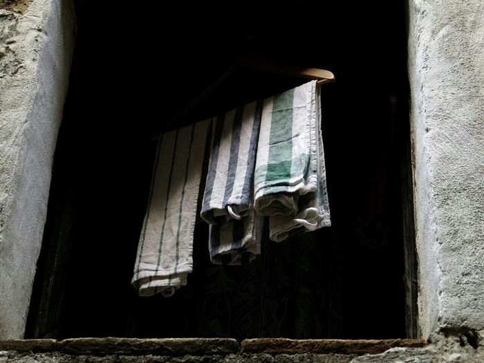 Dishclothes hanging between Light And Shadow , Houses And Windows , Old Village , Smart Simplicity Everyday Life