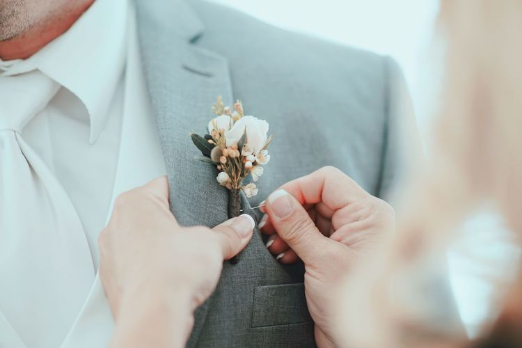 Suit Wedding Corsage Lapel Human Hand Hand Holding Human Body Part Midsection Flower One Person Men Adult Flowering Plant Real People Indoors  Plant Close-up Lifestyles Women Well-dressed Wedding Celebration