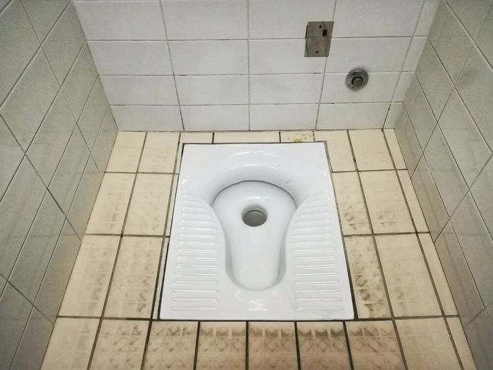 Dirty Floor White Tile Dirty Public Bathroom Turkish Bath Bathroom Tile Indoors  Tiled Floor High Angle View Hygiene Toilet Bowl Flushing Toilet