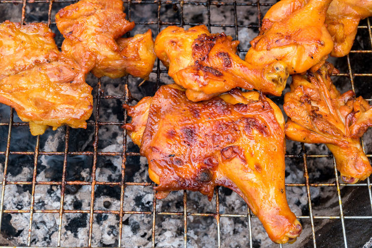 High angle view of chicken on barbecue grill